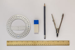 Ruler, compasses, eraser, protractor, pencil Stock Images