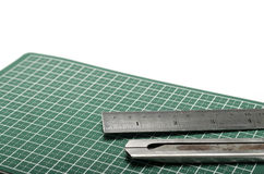 Ruler and cutter on cutting mat Royalty Free Stock Image