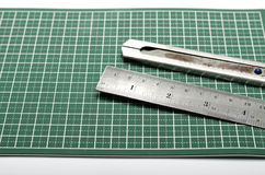 Ruler and cutter on cutting mat Stock Photo