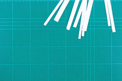 A ruler and cutter on green cutting mat Stock Photo