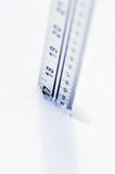 Ruler in deep snow Royalty Free Stock Photo