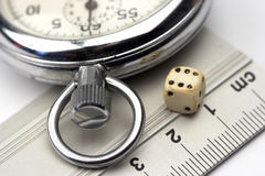 Ruler,dice and chronometer Stock Photography