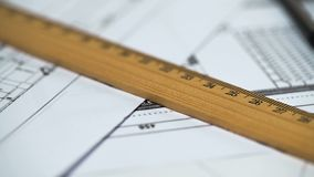Ruler on documents with building plan, architecture design, distance measurement. Stock photo royalty free stock image