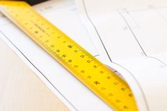 Ruler and drawings on the table Stock Image