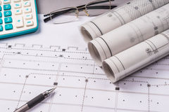 Ruler, eraser, glasses and a pencil on the floor plan - Bussines a still-life Royalty Free Stock Photos