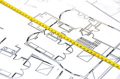Ruler on a floor plan Royalty Free Stock Image