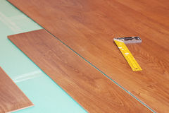 Ruler and laminate on substrate Stock Photos