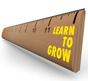 Ruler - Learn to Grow. A wooden ruler with the words Learn to Grow, symbolizing the benefits of lifelong learning Stock Image