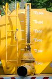 The ruler measurements at yellow truck water Tank. royalty free stock images