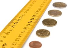 Ruler with money on white. Measuring money Royalty Free Stock Photo