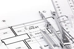 Ruler, pen and drawing compass on architectural drawing of house Royalty Free Stock Photos