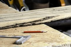 Ruler, pencil, board and sawdust. Stock Image