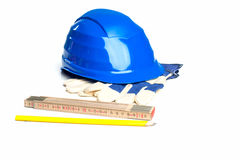 Ruler, pencil, helmet and gloves Royalty Free Stock Photos