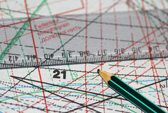 The ruler and pencil laying on sewing drawings. Macro shot royalty free stock photo