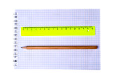 Ruler and pencil on notebook isolated on white background Stock Image