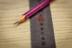 Ruler and pencil on a wooden background. Part marking. Carpenter`s workshop. Work carpenter. stock photo