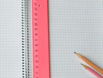 Ruler and pencils on copybook Stock Photo