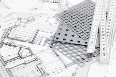 Ruler, perforated metal & architectural plans Royalty Free Stock Images