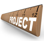 Ruler - Project Word School Homework Arts and Crafts. A wooden ruler with the word Project representing an assignment for school homework or an arts and crafts Royalty Free Stock Images