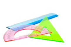 Ruler, protractor, triangle. On a white background royalty free stock photo