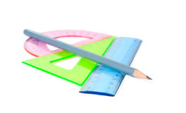 Ruler, protractor, triangle. On a white background stock images