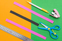 Ruler scissors stapler and hand cut paper straps Stock Images