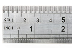 Ruler showing both metric and imperial measures of length. With shadow isolated on white background Royalty Free Stock Photo