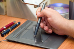 Ruler and tablet. A ruler being used on a tablet Royalty Free Stock Photo