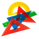 The ruler, triangle, protractor for the school. On a white background royalty free stock photos