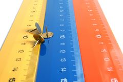 Rulers. Colour rulers with pushpins isolated on the white background stock image