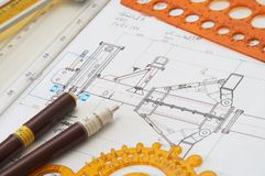 Rulers. Engineering drawing on drawing desk with rulers and pencils Stock Photos