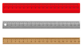 Rulers made of plastic wooden and metal Royalty Free Stock Photography