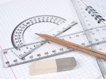 Rulers with pencil on the workbook page Stock Image