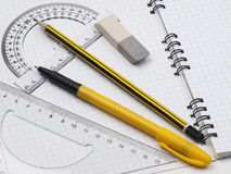 Rulers with pencil on the workbook page Stock Photography