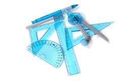 Rulers, triangles, protractor. School supples including rulers, triangles, protractor, pencil and pencil sharpener royalty free stock photo
