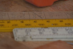 Rulers on workbench Stock Photo