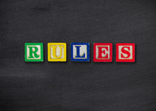 Rules concept. On black board Royalty Free Stock Photography