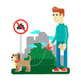 Rules dog walking in a city park Royalty Free Stock Images