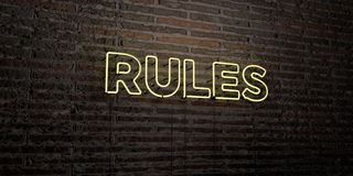 RULES -Realistic Neon Sign on Brick Wall background - 3D rendered royalty free stock image. Can be used for online banner ads and direct mailers royalty free stock photo