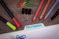 Rules And Regulations Concept. Folder Register on a dark wooden desk royalty free stock image