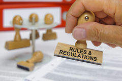 Rules and regulations. Marked on rubber stamp Royalty Free Stock Photo