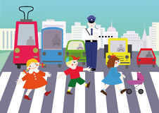 Rules of the road. Three children are at a pedestrian crossing by standing cars and police in the city Stock Photos