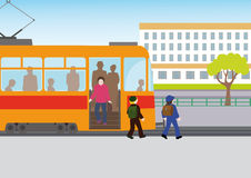 Rules of road. Children go out of the tram through the front door, and bypass it at the front Stock Photography