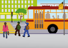 Rules of road. The children got off the bus at the bus stop and headed to a regulated pedestrian crossing on a green traffic light Royalty Free Stock Image