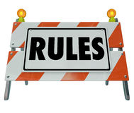 Rules Sign Barricade Guidelines Laws Compliance. Rules word on a road construction sign to illustrate following guidelines through compliance with gregulations Stock Photos
