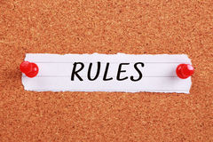 Rules. Text Rules written on note paper pinned on the corkboard Royalty Free Stock Photos