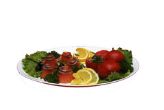 Ruletiki from a salmon. A meal is prepared from red fish and green-stuffs Royalty Free Stock Photo