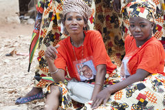 Ruling party suporters during electoral rallly in Mozambique. Nampula, Mozambique - October 11, 2014: Portrait of two beautiful women from Northern Mozambique Royalty Free Stock Photography