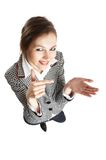 Ruling the World. Young attractive businesswoman with open palm toward camera - add your item - wide angle royalty free stock photography