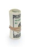 Rullande hundra dollarsedlar som binds med Arkivbild
